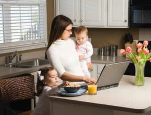 Lady working with children - how to be productive at home