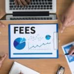 Fees graphic with hands on desk
