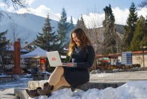 Image of a fully remote worker in a scenic setting