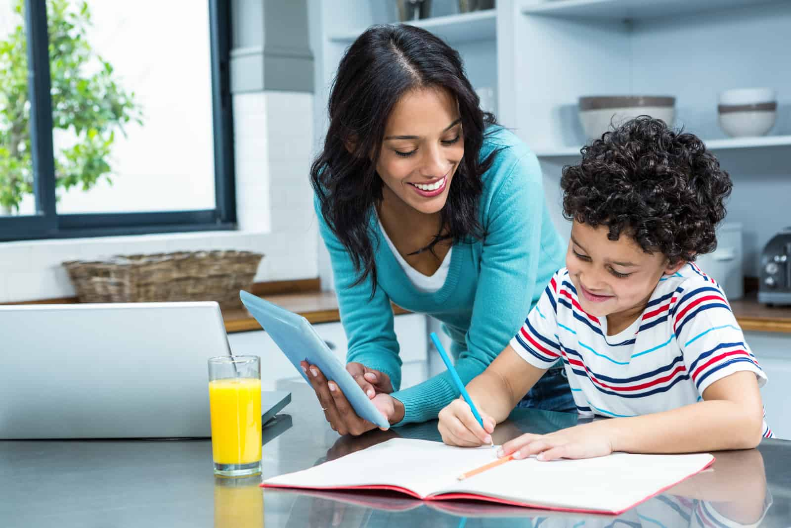 Stay at home working mom helping her son with homework